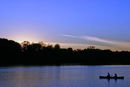 Couple fishing at dusk photo