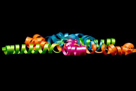 velvet background: Brightly colored ribbons on a black micro velvet background Stock Photo