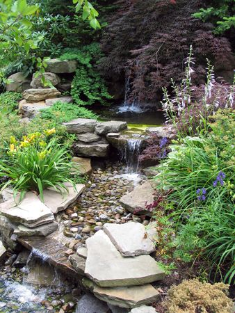 Small stepped waterfall in a landscaped oriental garden photo