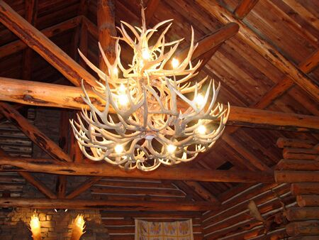 Chandelier made of antlers hanging in a rustic cabin photo