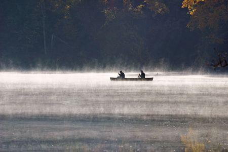 Canoeing in morning mist