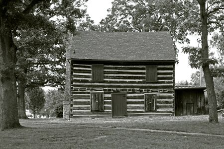 Reconstructed log cabin in City Park used as a museum photo