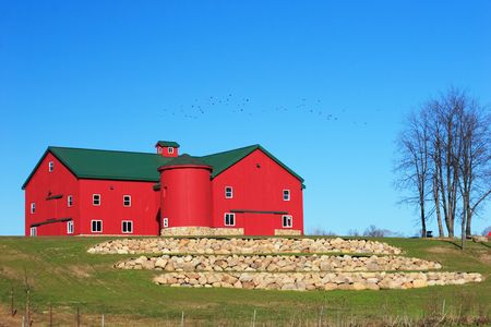 Newly built and landscaped Amish barn photo