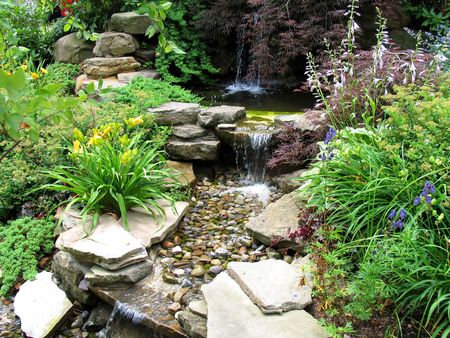Close-up of a small stepped waterfall and pool in a landscaped oriental garden
