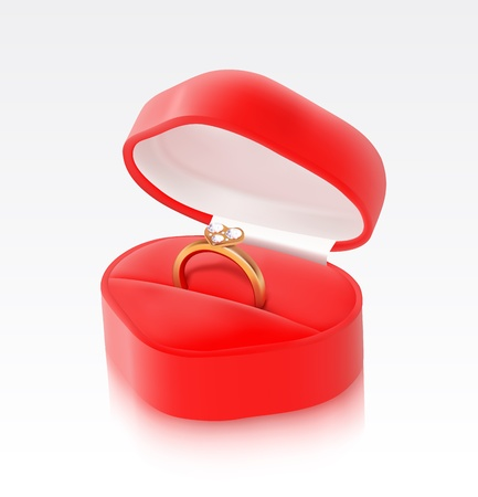 marriage proposal: Gold ring in a heart shaped box