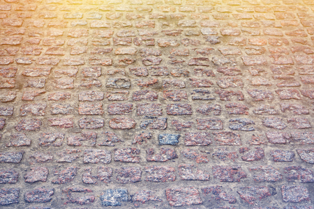 Stone blocks, angle view. The road  background. Toned. Stock Photo