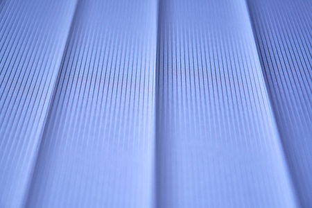 Blue vertical blinds. Abstract photo.