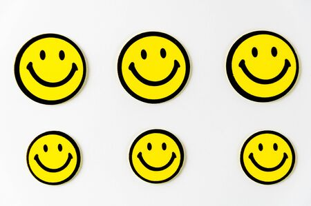 friendliness: Smiley face symbol note hanging on the rope Stock Photo