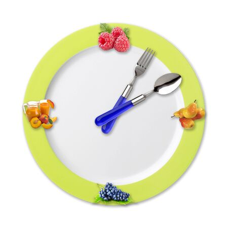 snack time: Kitchen clock with fruits isolated on white background Stock Photo