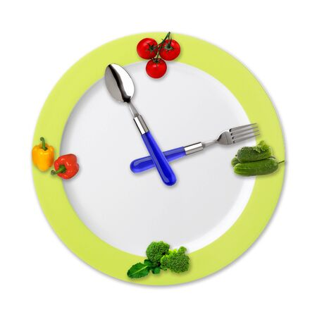 Kitchen clock with vegetables isolated on white background photo