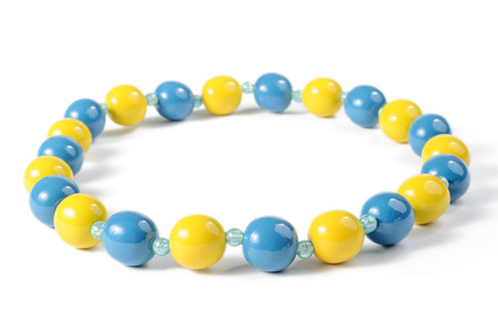 Blue and yellow beads isolated on white background photo
