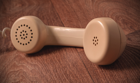 handset: Vintage telephone handset on old table photo. Stock Photo