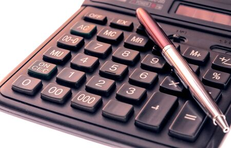 ball pens stationery: Calculator and pen isolated on white background. Foto de archivo
