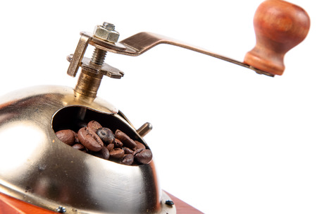 whine: Coffee grinder with coffee beans, isolated on white background.