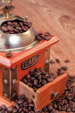 coffee grinder: Vintage manual coffee grinder with beans. Retro coffee grinder