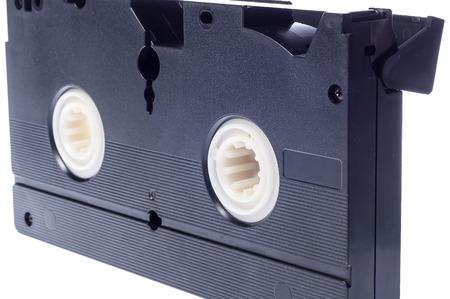 videocassette: Cinta de video aislada en el fondo blanco. Videocasetera Foto de archivo