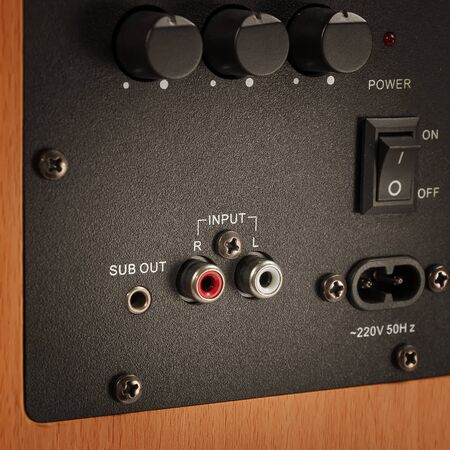 amp: Connectors and knobs of professional audio speaker. Connectors and knobs