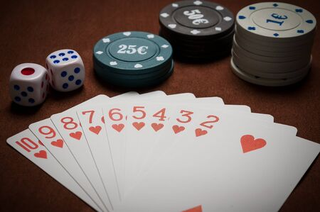 lear: Poker chips and generic playing cards. Courts for poker chips and dice on table Stock Photo