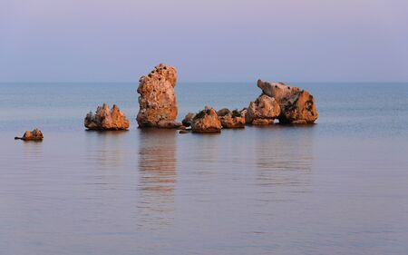 Stones in the sea. The Crimean coast in the summer.