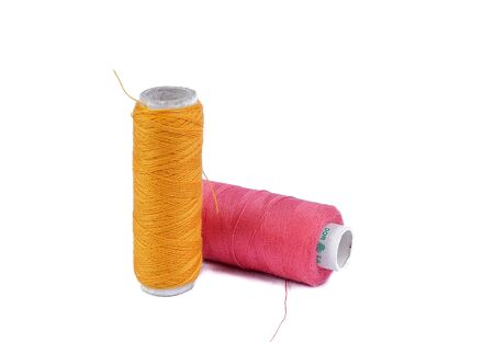 Sewing thread and needle on white. Threads for sewing Stock Photo