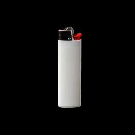 White lighter isolated on a black background