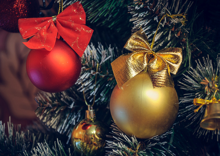 Christmas decorations on an artificial Christmas tree, a photograph in a vintage style. Stock Photo
