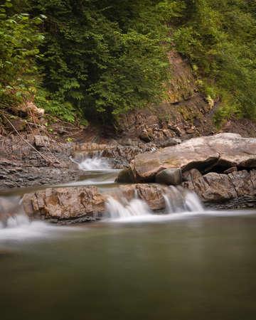 Beautiful cascade of mountain waterfall in Ukrainian Carpathians.