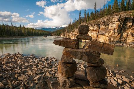 laying forward: A small stone Inukshuk near Athabasca Falls.