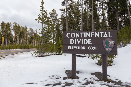 sign: Sign marking the Continental Divide and an elevation of 8391. Editorial