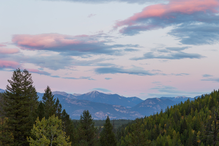 The sun sets over the Kootenay Rocky Mountains near Panorama and Invermere BC.