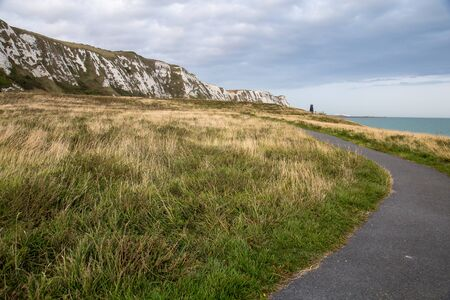 A walking path meanders near the White Cliffs of Dover.