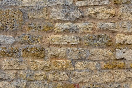 Old and weathered brown brick wall.