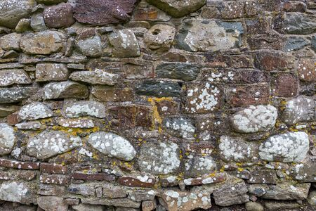 An old and weathered stone wall.