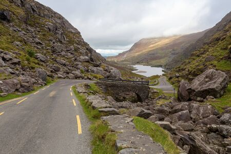 Road with a lake in Dunloe Pass
