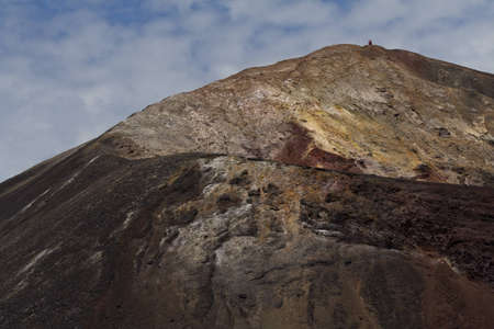 far off: A view up and along the crater rim of the volcano Cerro Negro with a person standing at the far off tip