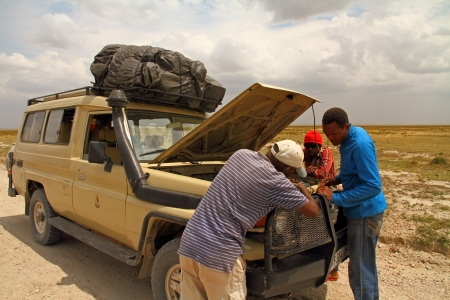 Fixing a broken down safari truck while on route Editorial