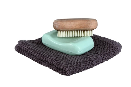 face cloth: A simple mans face wash collection isolated over white.  Includes face cloth, bar of soap, and a scrub brush.