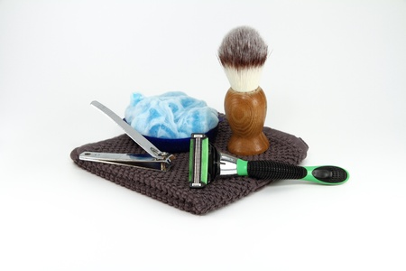 A simple collection of manly shaving and grooming supplies. photo