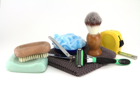 A collection of bathroom supplies used by a simple working man, also seen with a tape measure.