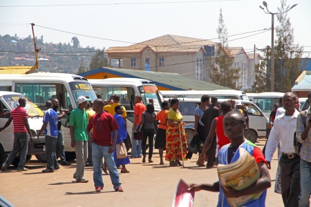 People moving and working in the busy bus station of Kigali, Rwanda, Africa
