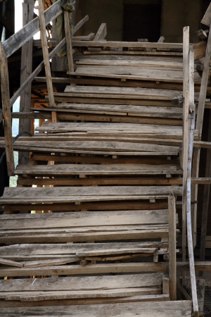 poorly: An old and rickity wooden staircase very poorly constructed