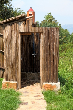 bunyoni: an outdoor shower with water that is heated from a solar water heater up the hill.  Gravity brings the water to the shower, heated from the sun.
