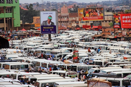 kampala: KAMPALA, UGANDA - SEPTEMBER 28, 2012.  The public transportation hub in downtown Kampala, Uganda.  Taxis (buses)  wait for passengers in the large and crowded taxi park in Kampala, Uganda, on September 28, 2012. Editorial