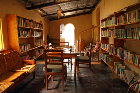 bunyoni: LAKE BUNYONI, UGANDA - CIRCA SEPTEMBER 2012.  A small and quaint library in Uganda on the shores of Lake Bunyoni sits ready for use.