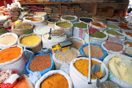 Bags of food staples in an open air market in Kampala, Uganda   Seen are beans, buts, grains, corn, spices, pastas, sugar, rice
