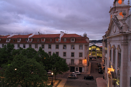 The Church Paroquial de Sao Paulo in the Cais Sodre area of Lisbon along with the trees and homes in the plaza in front   In the background is seen the back entrance to the Mercado Ribeira  Ribeira Market