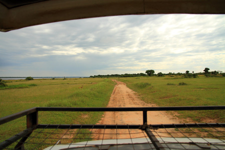 Looking out over the Ugandan savannah, in Murchison Falls National Park, from on top of a safari truck. Stock Photo