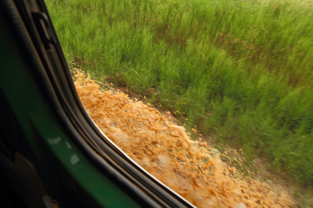 Looking out the windown while driving through a mud puddle on the Ugandan savannah