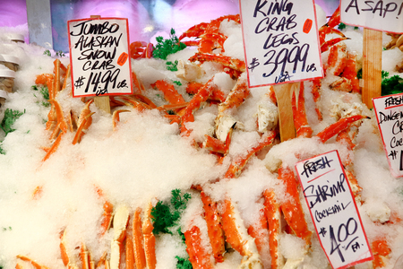 Closeup view of large crab legs for sale in a public market.