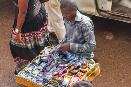 KAMPALA, UGANDA - OCTOBER 03, 2012.  A man sells cell phone cases at the taxi park in Kampala, Uganda on October 03,2012.